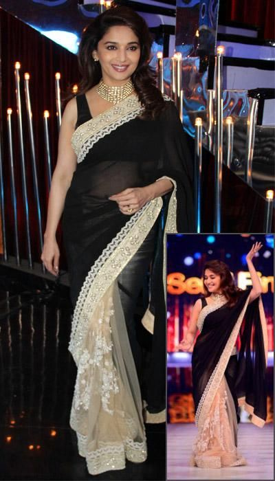 The addition of off-white lace to the black makes a simple saree look stunning.
