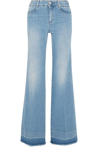 Stella McCartney's jeans are slightly faded for an authentic love-worn look. This blue stretch-denim pair has a frayed, unfinished hem. Wear yours at the weekend with an airy blouse.