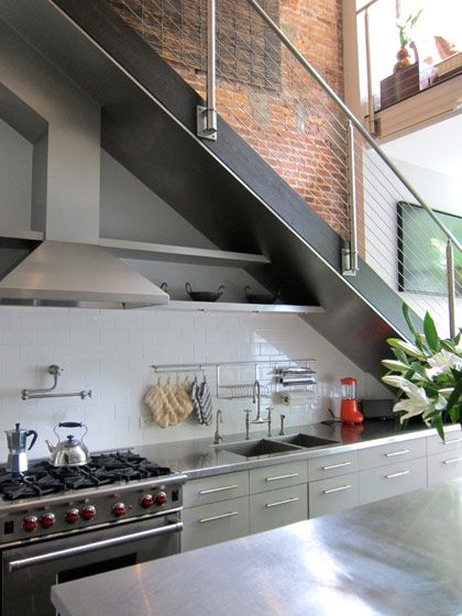 Love the stainless steel counter with integrated sink and subway tile backsplash