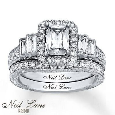 This breathtaking bridal set from Neil Lane Bridal® is a stunning array of radiant-cut, baguette and round diamonds set in 14K white gold. The vintage-inspired bridal set has a total diamond weight of 2 3/8 carats. Diamond Total Carat Weight may range from 2.37 - 2.44 carats.
