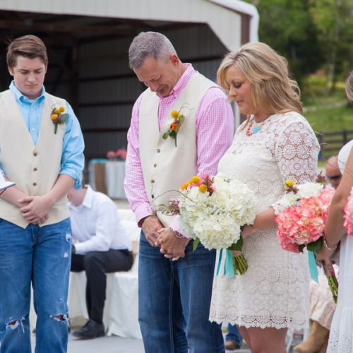 Christian Wedding Ceremony: Everyone Bows Their Head In Prayer As They Start Their