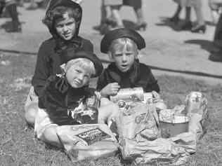 Ekka (c.1936) - enjoying the spoils. Things never change. Show bags were free in these days and known as 'sample' bags.