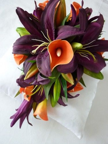 purple casablanca lily's, and orange cala lily's... Maybe I do like jewel tones!!! I need to choose!!!