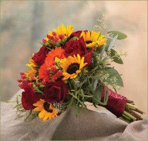 Fall Bouquet with Gorgeous sunflowers, gerbera daisies, hypericum berries, roses, queen anne's lace and seeded eucalyptus all tied together with a stunning deep red satin ribbon.