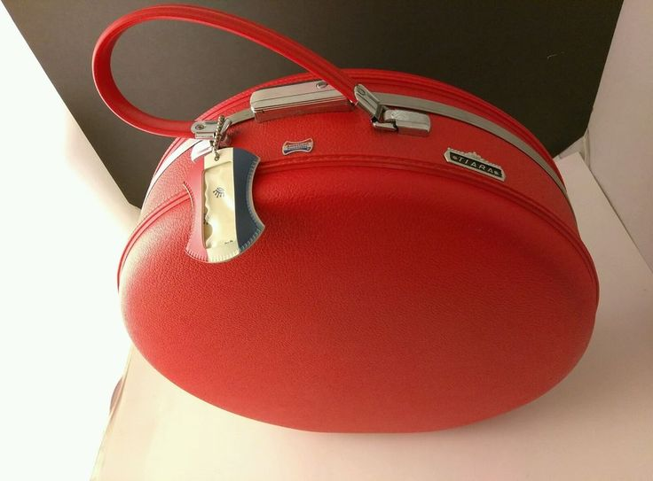 """Item for sale is a Vintage American Tourister Tiara Suitcase. It's red and round. It's the Tiara line. Very few scuffs or markings, has I.d. tag and lining. 16""""   Lid lining has a small snag as seen in last pic.    See pics!   eBay!"""