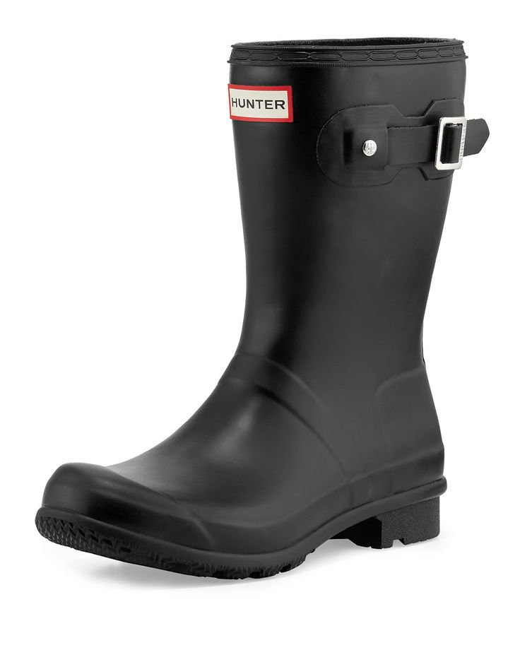 "Hunter Boot lightweight matte rubber rain boot can be rolled for easy packing. 1"" flat heel; 10.8""H shaft. Round toe. Decorative buckle strap at top. Logo patch at top center. Includes drawstring bag."