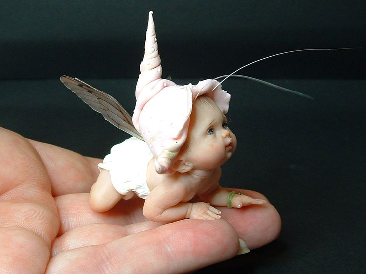 """Sweetly posed baby fairy doll! Prosculpt Awardees 2011 """"Artist: Diane Guelinckx 1st Place Baby Category. Diane sculpted this ProSculpt baby fairy from her home in Belgium. Kruipertje is only two inches long. DIane is a self taught world class sculptor. To see more of her work click on... http://enaidsworld.blogspot.com/ """"                                                                                                                                                      More"""