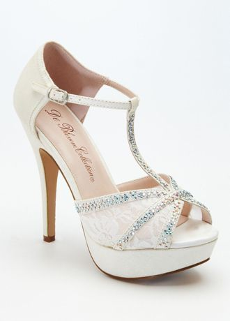 "Step out in style in these high voltage T-strap sandals!  High heel platform pump with t-strap has crystal and lace detailing.  Buckle closure.  Heel height: 4 3/4"".  Available in Champagne, Silver Metallic and White.  Imported."
