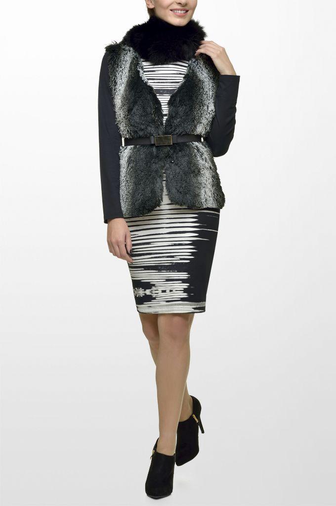 Sarah Lawrence - long sleeve jersey dress, fake fur vest, leather belt.