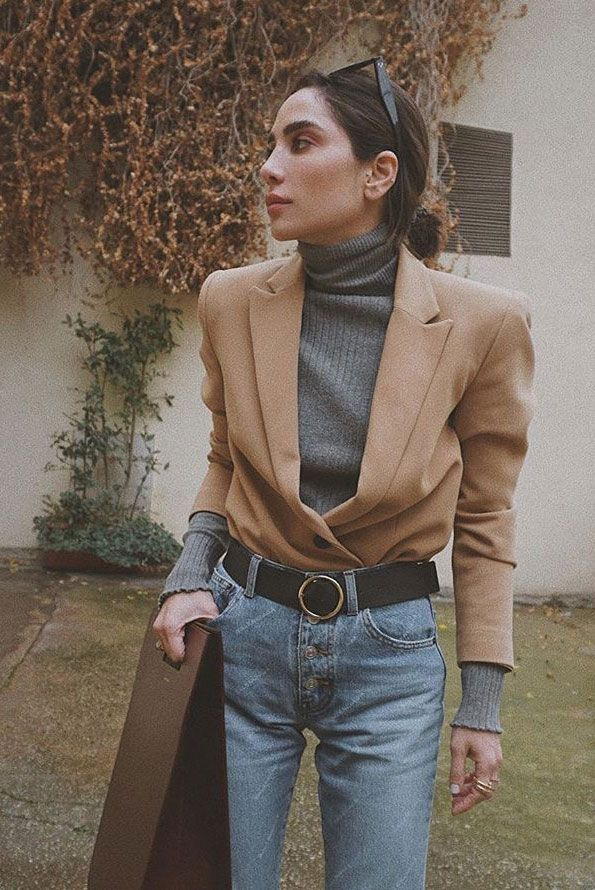 The Tucked In Blazer Style We Are Obsessing Over: Fashion & music blogger 'D Tales' wearing a tucked in camel blazer, a grey turtleneck, a black belt, straight jeans, chunky sneakers, black sunglasses and a structured tote. Fashion 2018, fashion trends 2018, spring fashion, fall fashion, tucked in blazer, check blazer, jeans, blazer and jeans, blazer, fashion influencers, camel blazer, fall layers, spring layers, blazer layers.