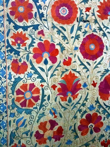 we could mount a suzani like this behind your bed to upholster the wall/create a headboard