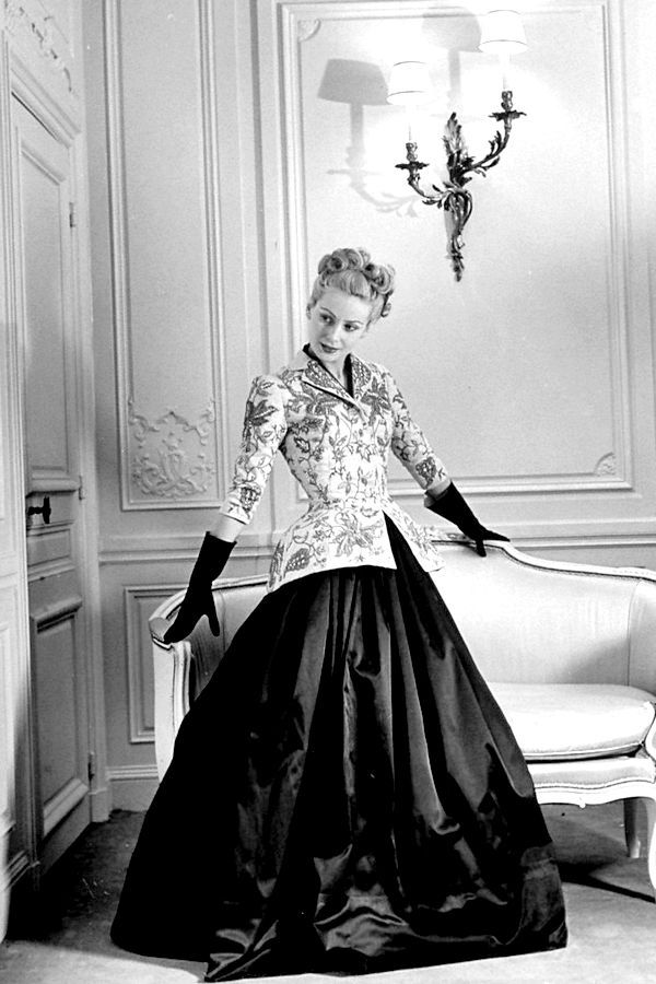 Model wearing an evening ensemble by Christian Dior in a 1947 photo by Willy Maywald for ELLE magazine