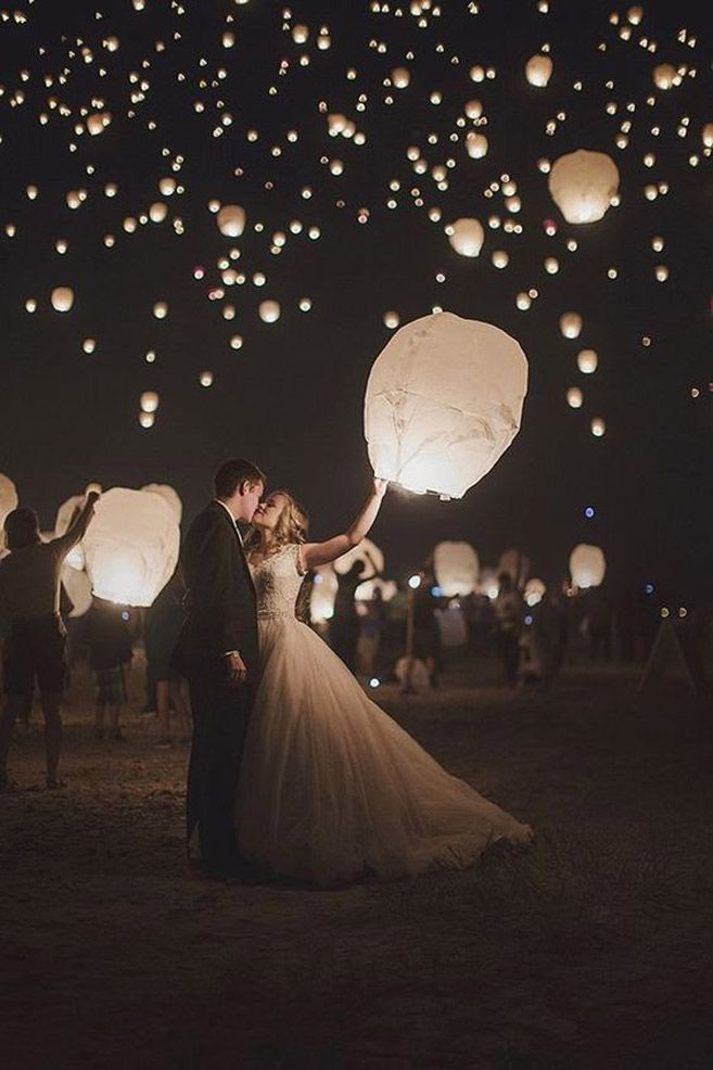 What's more magical than a night sky dotted with glowing lanterns set free by your guests at the end of the night?     Image via  Wedding Exits.