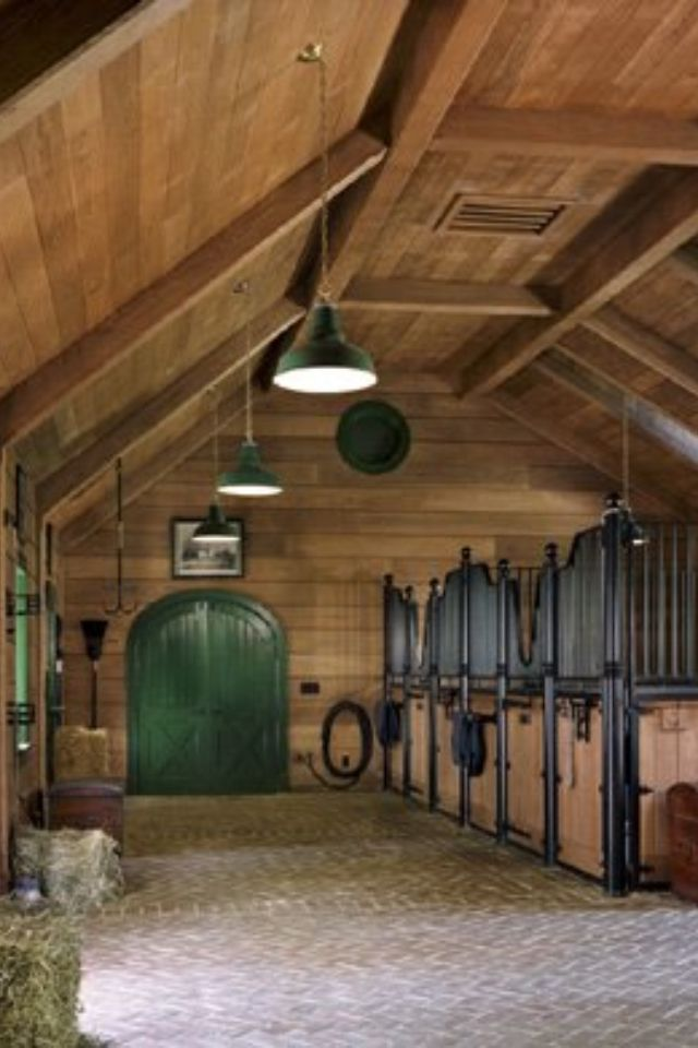 Love this barn. Love the high ceilings and the stall doors so the horses can put their heads out and greet you.