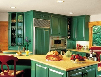 Green kitchen cabinets... you don't see those too often. It's a nice shade, though.