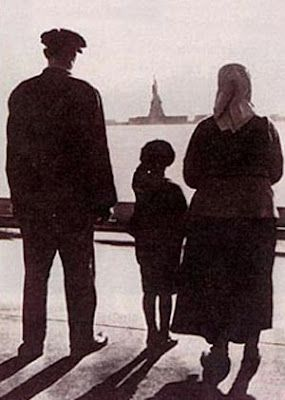 Ellis Island Immigrants to America gazing upon the famed, Statue of Liberty -- New York harbor.