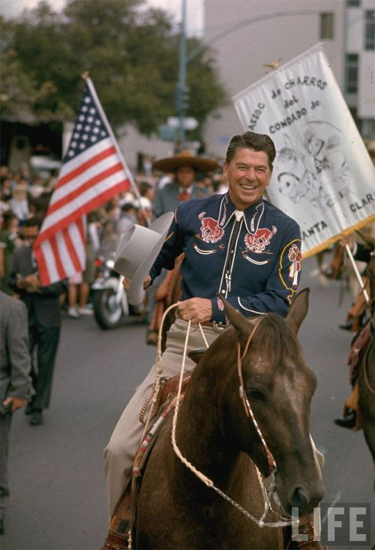 CA Republican gubernatorial candidate Ronald Reagan, clad in cowboy attire, riding horse outside while on campaign trail. 1966.