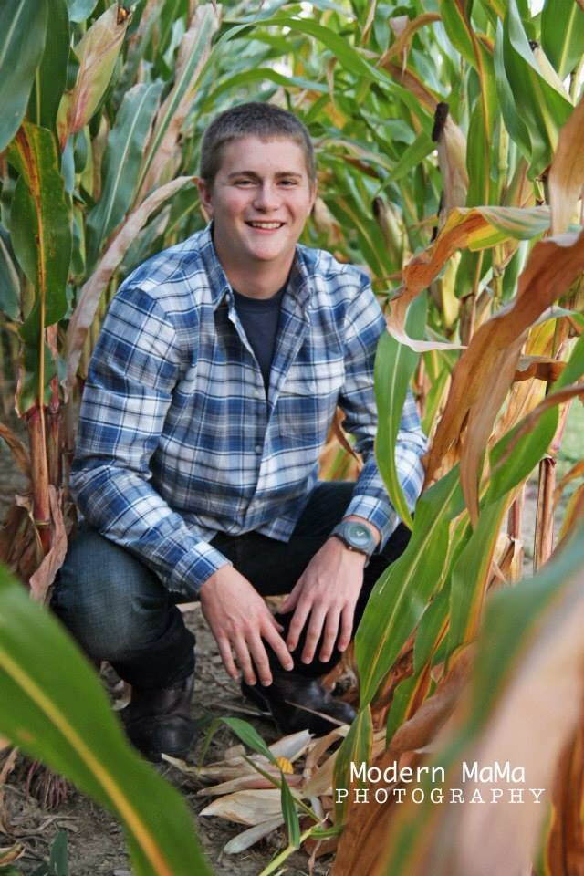 Senior pictures. In a corn field