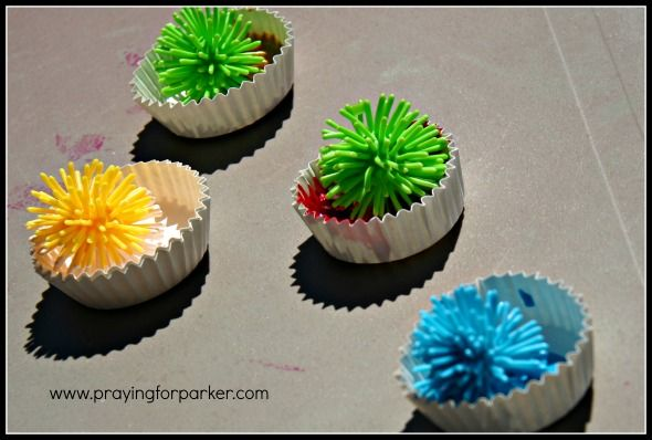 Place Koosh balls in paint then throw at or roll on paper to make fireworks! We could do this with pudding or frosting to make it an edible activity! *pinned by WonderBaby.org