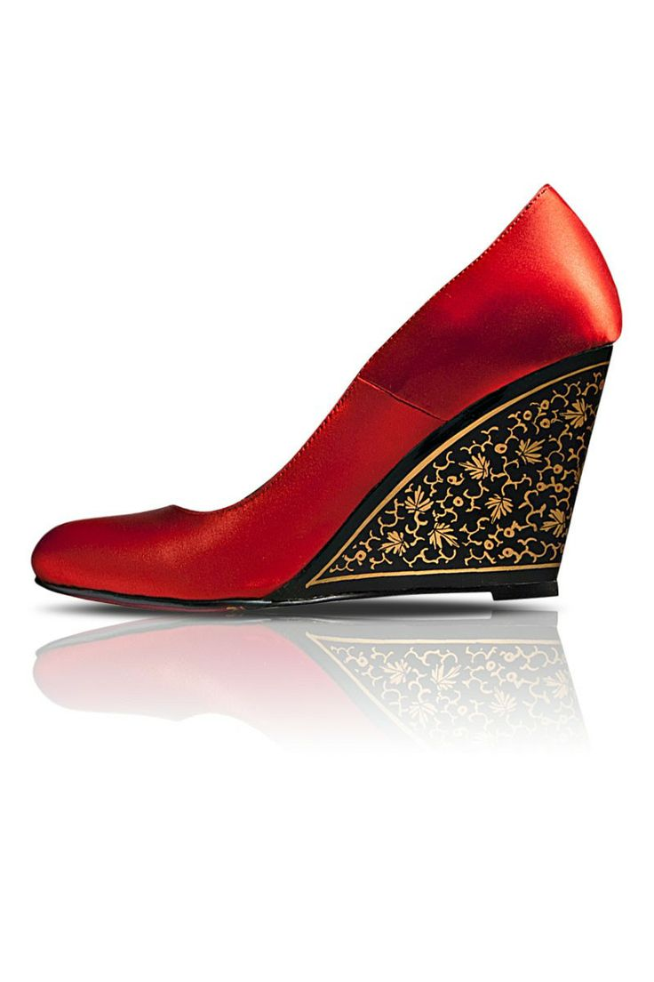 Red Chinar Wedge Heels - Crafted in sheer luxury, these silk crafted wedge heels exude a rich feminine charm. An exquisite hand painted pattern on the heels adds an unseen magnificence. Cushioned insole guarantees a comfortable footbed. Brightens up your traditional as well as contemporary ensembles.   Colour:  Red.  Material:  Hand Woven Silk, Leather lining, Rubber Sole.  Heel Heigh:  3.5 inch.  Estimated delivery within 14 - 21 days after ordering.