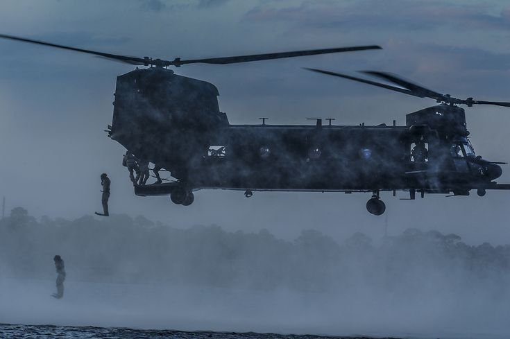 Airmen from the 23rd Special Tactics Squadron jump out the back of a MH-47 Chinook Helicopter April 9 2013 [2100 x 1397]