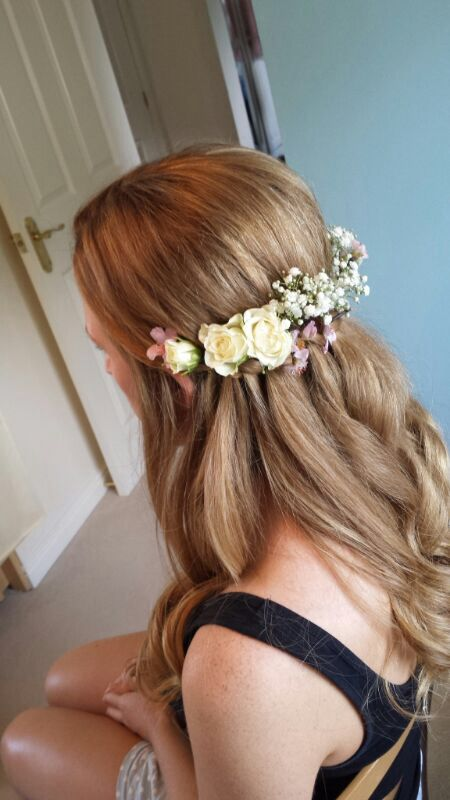 another example of hair piece. I like the mix of small/medium flowers and the foliage/baby's breath. I prefer the flowers to be more restricted to one side of the braid rather than all across the back like in this picture.