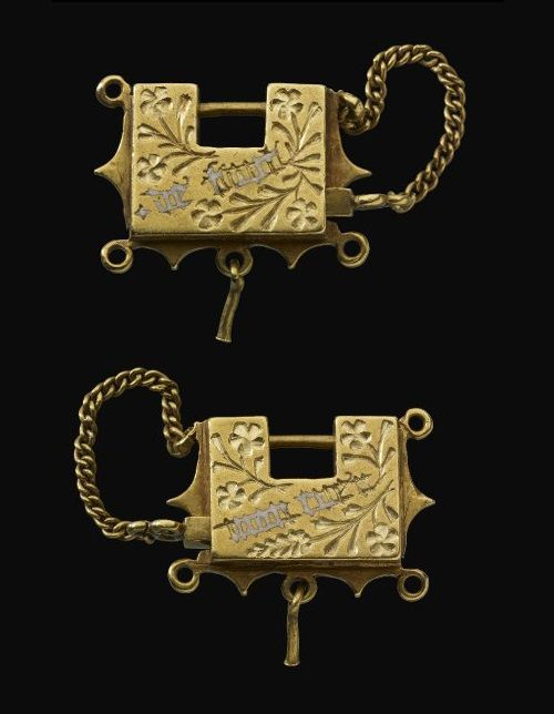 "Padlock locket, made in England, 1400-64. The inscription reads: ""de tout mon cuer"" (with all my heart) (source)."