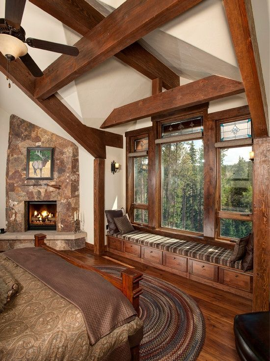 Hmm....for master bedroom, large windows with window seats and storage space under, white/wood like this, fireplace....debating about the vaulted ceiling, but I sort of like it... -SR