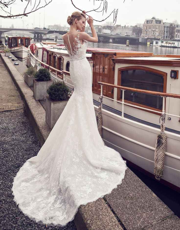 AMSTERDAM // The perfect combination of the finest bridal lace and tulle creates the perfect wedding dress with a plunging neckline and low illusion back
