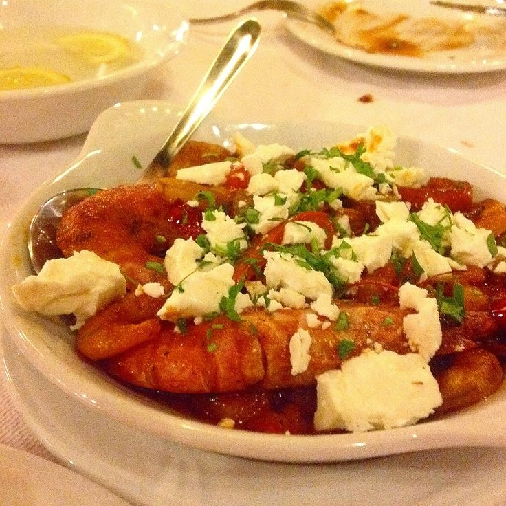 Shrimp Saganaki...fresh shrimps flamed in ouzo then cooked in a fresh tomato sauce with peppers and topped with feta. #greek #shrimp #saganaki #fresh #fish