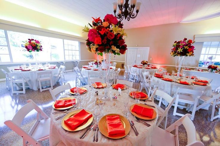 Breathtaking #centerpieces  venue with red accent #uplight lighting! Great photo via #beautifultampaweddings