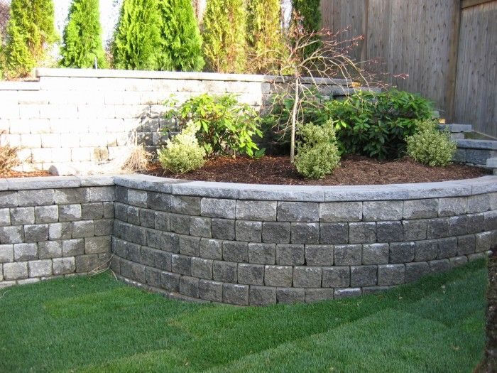 Interlocking dry stacked concrete block wall not the most for Curved garden wall designs