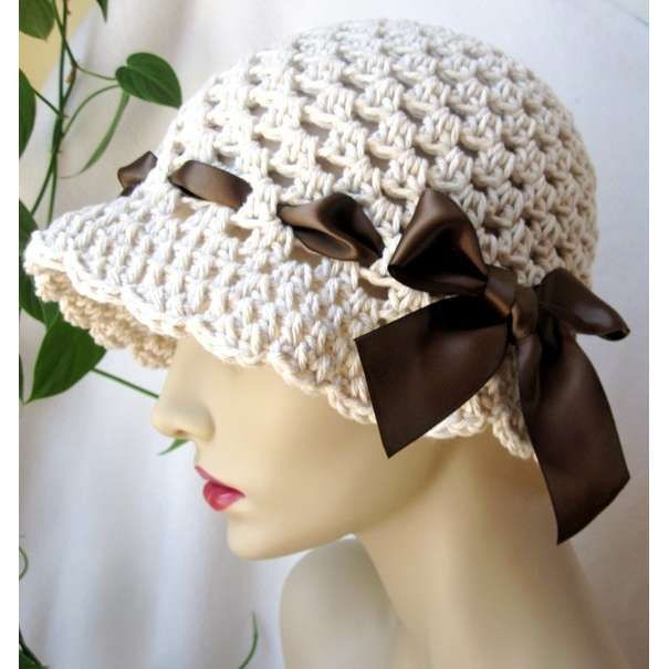 Crocheted hat with woven ribbon. Love this!