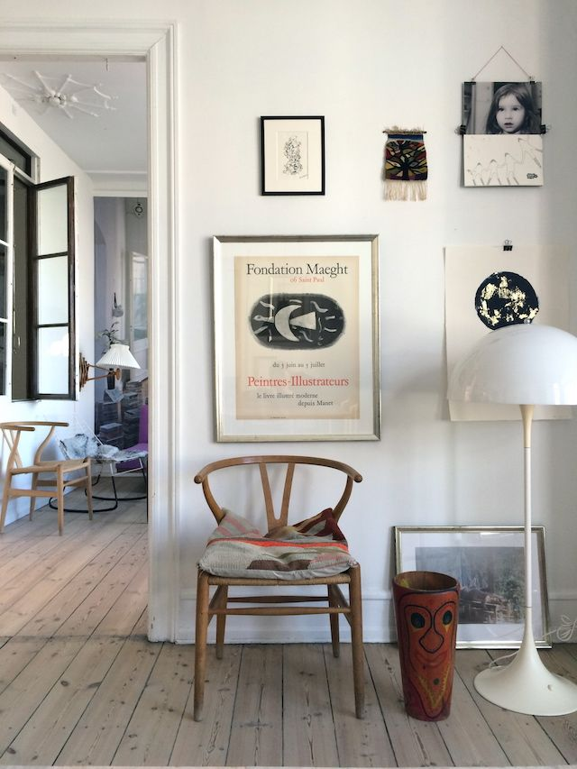 Love the bare wooden floors & artwork on the wall