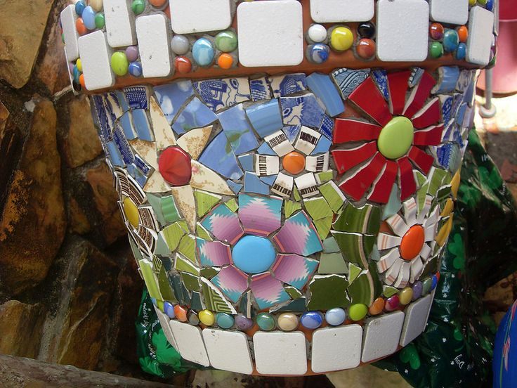 Large Mosaic Fun Pot. Outside is done. This flower pot will be grouted in a darkish grey.