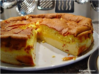 Eierschecke ohne Boden  Ingredients:  375 ml milk  350 g sugar   2 package of vanilla pudding  100 g butter  6 eggs (separated)  750 g low fat curd cheese