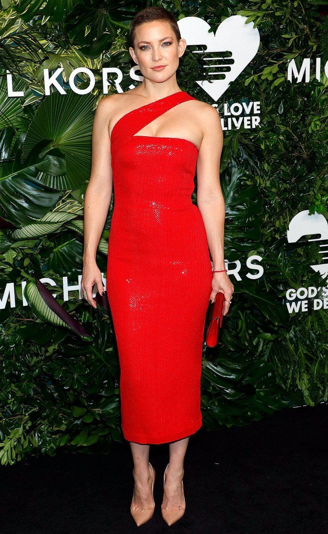 Kate Hudson in a red one-strap Michael Kors midi dress