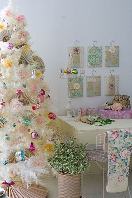 I am actually kind of digging the idea of a white Christmas tree. I would never replace my real tree, simply add a white one to another room!