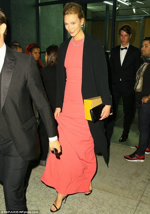 Glam gal: Karlie Kloss appeared elegant in a coral gown as she attended the opening night of Carnegie Hall in New York City on Wednesday