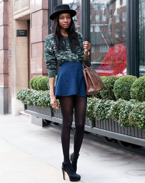 Patterned sweater with blue mini skirt, combined with black hat