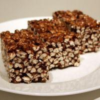 Puffed Wheat Squares Recipe - Made these last week - They were good, stuck together nicely super easy to make - I think next time I would use 1 1/2 or 2 times the chocolate sauce - They weren't quite as chocolatey as I like it - Mine were not NEARLY as dark as shown in the picture.