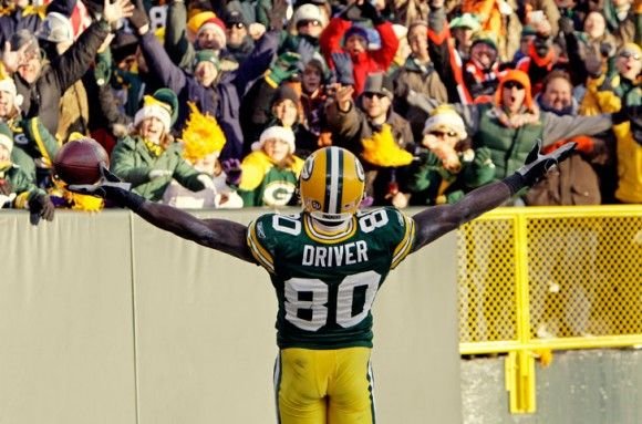 Green Bay Packers wide receiver Donald Driver celebrates after catching a 71-yard touchdown pass during the second half of an NFL football game against the Detroit Lions Sunday, Dec. 28, 2008, in Green Bay, Wis.