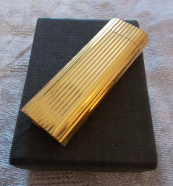 Vintage Cartier original gas/butane gold tone by mademeathens  more to see www.etsy.com/shop/mademeathens #vintage #cartier #lighter