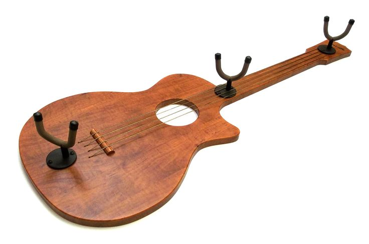 Beautifully hang up to 3 acoustic, electric, or bass guitars in your home or studio. Conserve space and accent your room using the guitars you're already proud of! Plus, keep your guitars safe from the floor and forgettable wall-hooks. Many body styles and finishes to choose from at www.WallAxe.com. This NEW & unique gift starts at $79. Proudly made in USA.