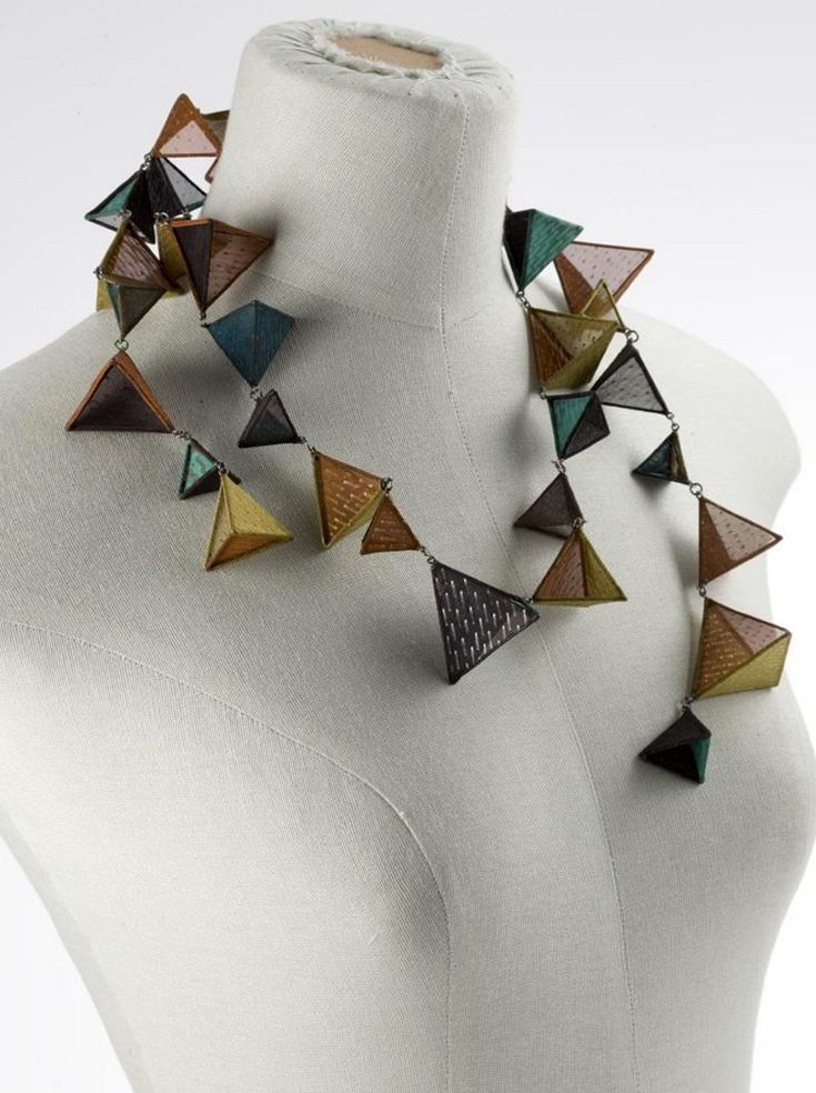 Necklace | Suō, Emiko.  36 linked hollow prisms of stainless steel, each covered with copper mesh in colours of gold, tan, turquoise, blue, bronze and black