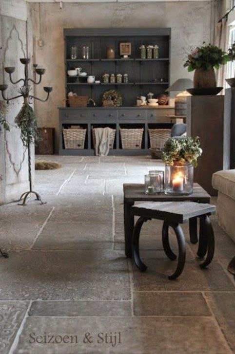 I love the serene feel and the color scheme. The textures of the plaster walls, stone floors, painted and natural woods, baskets, and linens. This is one of my favorite looks. It is from Scizoen & Stijl