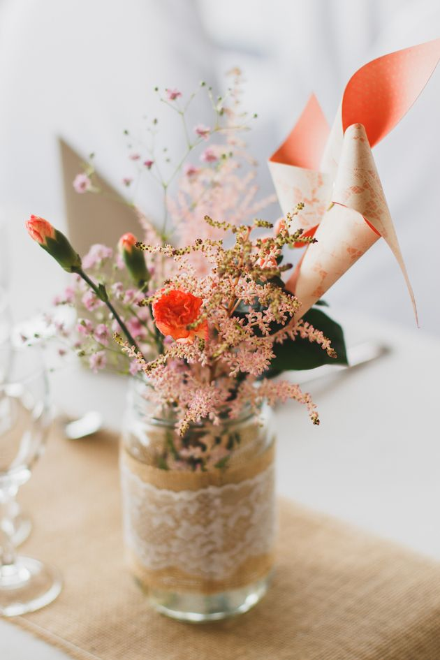 Sweet wedding centerpiece idea alert! Mason jars wrapped with burlap and lace filled with flowers plus paper windmills for a dash of whimsy!   Marine Szczepaniak Photography