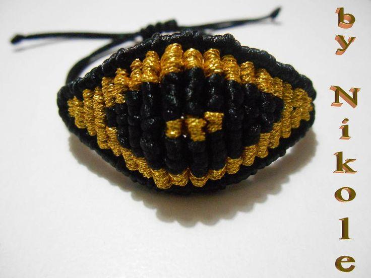 black/gold evil eye
