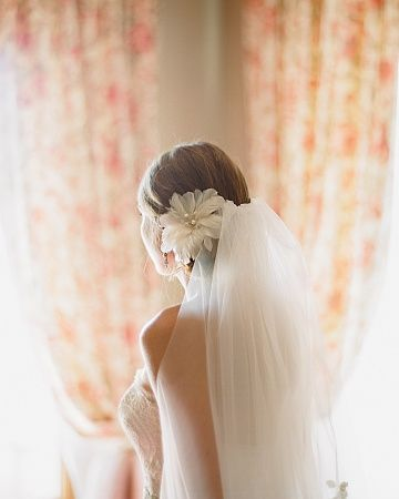I love the flower and veil placement