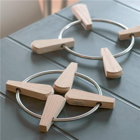 I absolutely love this Folding Trivet By Skagerak: Made of oak and stainless steel.. #product #design #creative